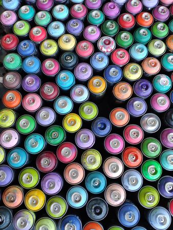 Used paint for graffiti. Balloons for graphiti aerosol paints with capes. Multi-colored tools for street art. Assortment of colors Standard-Bild