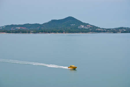 speed boat in the sea moving boat speed line photo