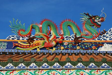 traditional chinese dragon at the temple nice blue sky photo