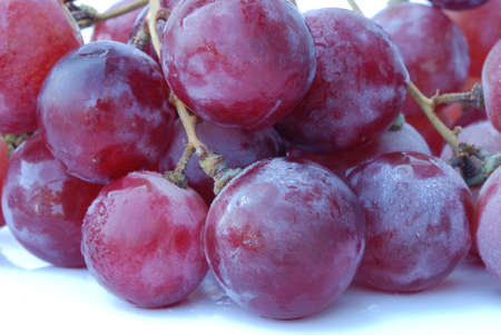 close up of red grape isolated on white background photo
