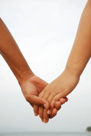 adult dating: Sign of love with two lover hands together Stock Photo