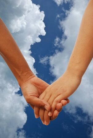 2 persons: Sign of love with two lover hands together Stock Photo