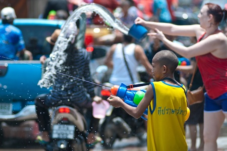 KO SAMUI, THAILAND - APRIL 13,2011 - travelers picture at songkran festival in Ko Samui island, Thailand. The Thailand new year   festival called songkran festival.