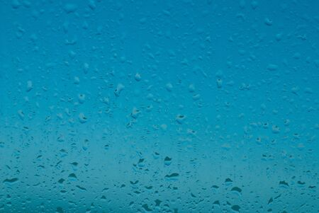 close up of water drop on the glass blue tone Stock Photo - 9633020