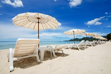 very nice white beach umbrella at nice dark blue sky Stock Photo
