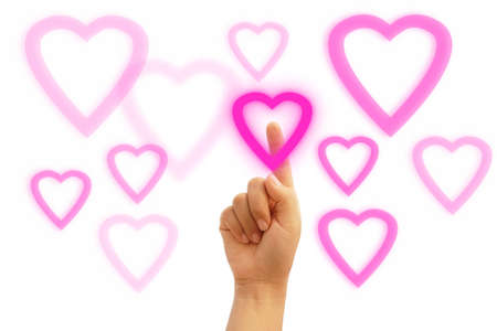 lady hand choosing pink heart isolated on white background photo