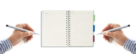 hand writing on notepad isolated on white background photo