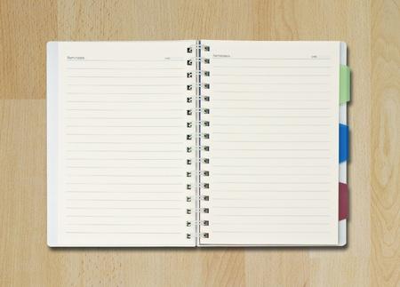 single blank notepad on wood floor Stock Photo - 9920027