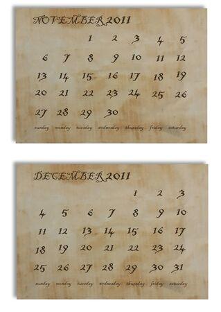 November and December 2011 calendar on old paper background photo