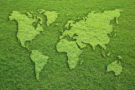 world map on grass field texture photo
