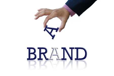 brand: art work of business hand with the business word Stock Photo