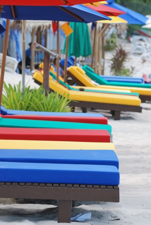 many of colorful beach chairs on the beach with shallow depth of field Stock Photo - 9921582