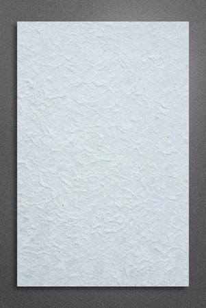 blank white paper on metalic background photo