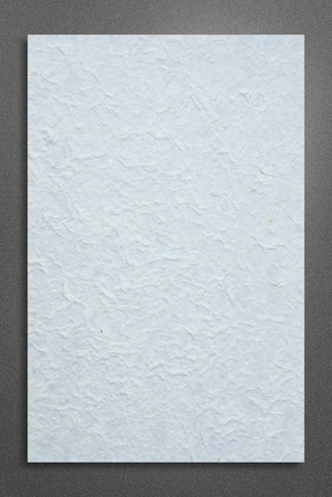 blank white paper on metalic background