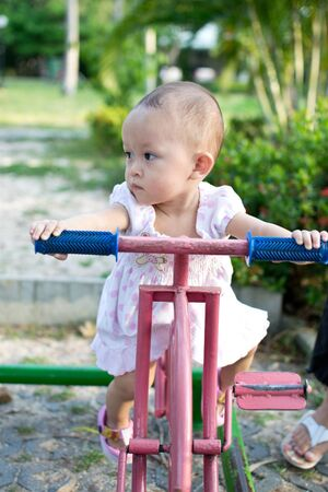 activity of cute young asian kid in the playground Stock Photo - 10058574