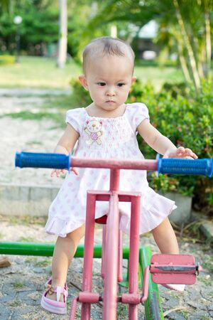 Cute young asian kid in the playground Stock Photo - 10065609
