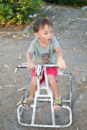 activity of cute young asian kid in the playground photo
