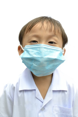 cute asian young boy wearing disposable face mask on white background.