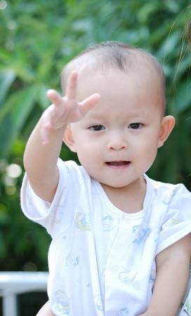 a cute young asian baby in daily activity. Stock Photo - 10058416