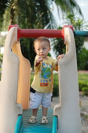 almost two year old asian boy with activity in playground. Stock Photo - 10058491
