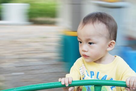 almost two year old asian boy with activity in playground. Stock Photo - 10058530