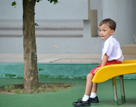 a cute young asian baby in daily activity. Stock Photo - 10058439