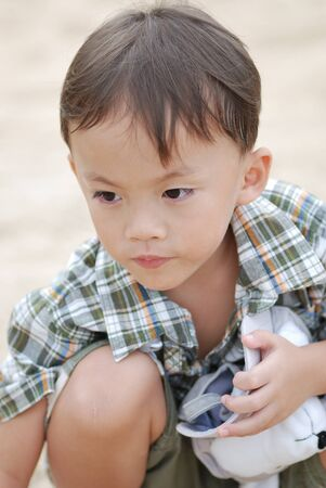 a cute young asian baby in daily activity. Stock Photo - 10058462