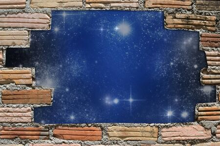 abstract idea from galaxy through  of old brick wall hole. photo