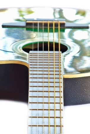 close up view of green color acoustic guitar. photo