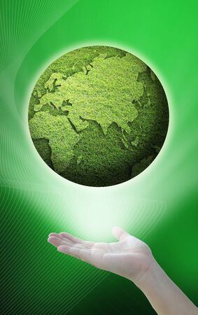 environment idea from green globe over the hand. photo