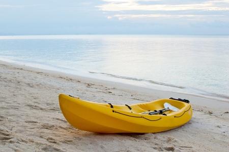 single yellow kayak on thebeach at twilight. Stock Photo - 10356364