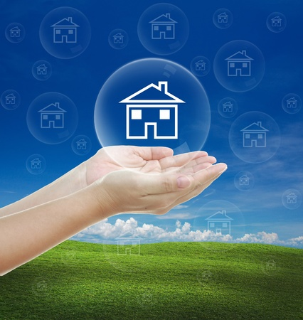 hands holding house: attractive idea for business on the nice background. Stock Photo