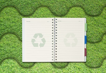 single blank notepad on attractive grass background. photo
