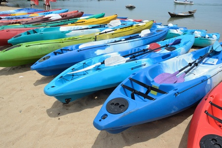 group of colorful kayak on the beach.