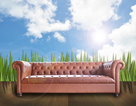 art work of single vintage style sofa on nature background. photo