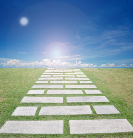 abstract picture of nice form of walkpath on grass field with blue sky. photo