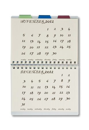 The 2012 calendar on notepad with white background. photo