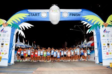 quater: KO SAMUI, THAILAND - SEPTEMBER 18: Samui Island Marathon 2011 at ko samui on September 18,2011 in Ko   Samui island, Thailand. The international marathon with 5,000 people to participate. Editorial