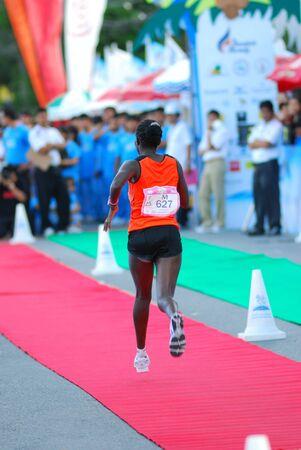 quater: KO SAMUI, THAILAND - SEPTEMBER 18: Particpants of the 2011 Samui Island Marathon at Ko Samui on September 18,2011 in Ko Samui Island, Thailand. Approximately 5,000 people particpate in the   international marathon.