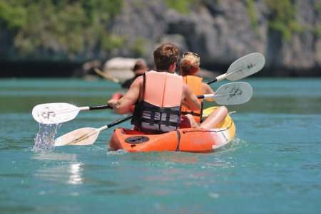 ocean kayaking backward view of traveller.