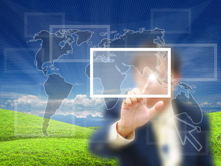 Businessman touching virtual screen on nature background. photo