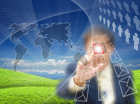 Businessman touching virtual screen on nature background. Stock Photo - 10751246