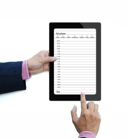 The daily planner on touch screen computer over white background. photo