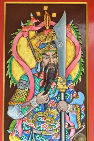chinese hero or god on the wood door of chinese temple.