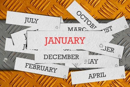 january calendar: name of month on old metal background. Stock Photo