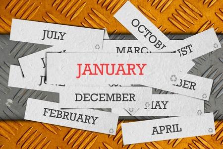 enero: nombre del mes en el antiguo fondo de metal. Foto de archivo
