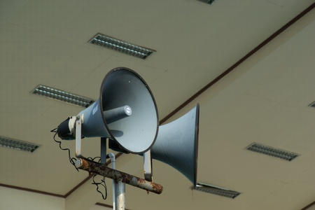 public address: old fasion speakers on metal stand.