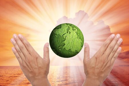 An idea of safe the earth by hands and globe. photo