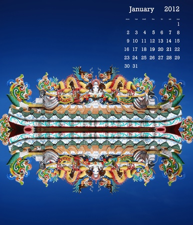 2012  carlendar on dragon sculpture on the roof in blue sky day. Stock Photo - 11007651