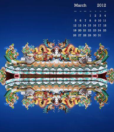 2012 calendar on dragon sculpture on the roof in blue sky day. photo